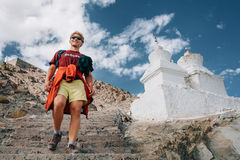Young tourist man visit the tibetian holy places in Himalaya mou Royalty Free Stock Image