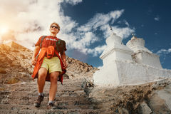 Young tourist man visit the tibetian holy places in Himalaya mou Royalty Free Stock Photography