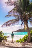 Young tourist man walking to the on caribbean island Stock Images
