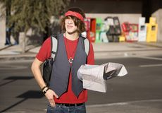 Young Tourist with Map. Handsome Young Male Tourist with Crumpled Map Royalty Free Stock Photos