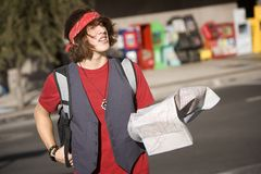 Young Tourist with Map. Handsome Young Male Tourist with Crumpled Map Royalty Free Stock Photo