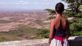 Young tourist observing a tuscan landscape. Italy, Tuscany. typical landscape and young woman stock footage