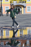 Young tourist reflections in city square Stock Photography