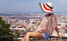 Young tourist sitting on handrail on the top of city Royalty Free Stock Images