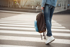 Young tourist stepping across route stock images
