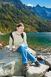 Young tourist on a stone in the Tatry mountains Royalty Free Stock Photos