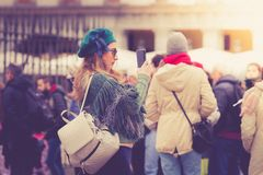 A young tourist take photos in the Plaza Mayor, Madrid royalty free stock image