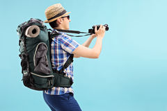 Young tourist taking a picture with camera Royalty Free Stock Photography