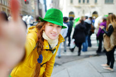 Young tourist taking a selfie during the annual St. Patrick's Day Parade in New York Stock Photos