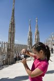 Young tourist on the top of Duomo di Milano Stock Photography