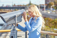 Young tourist using telescope  tower observation deck i Royalty Free Stock Photography