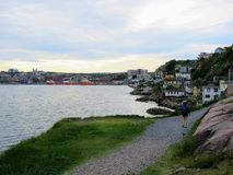 A young tourist walking along the shore from Signal Hill through royalty free stock image