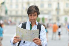 Young tourist watching the map Royalty Free Stock Photography