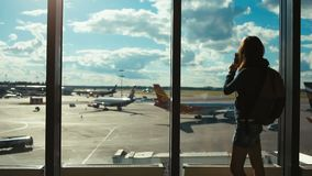 Tursit woman in the airport shoots photos on the smartphone stock footage
