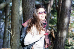 Young tourist woman with backpack in the forest stock photography