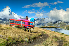 Young tourist woman with backpack relaxing on bench Royalty Free Stock Photo