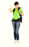 Young tourist woman with backpack and thumb up Royalty Free Stock Image
