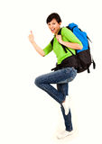 Young tourist woman with backpack and thumb up Stock Photography