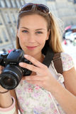 Young tourist woman with camera Stock Image