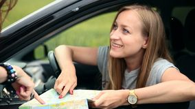 Young tourist woman with car asking for direction stock footage