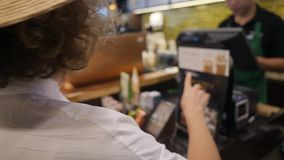 Young Tourist Woman Customer at Coffee Shop Counter Making Order. 4K. stock footage