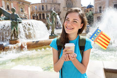 Young tourist woman drinking coffee happy smiling in Valencia, Spain. Stock Photos