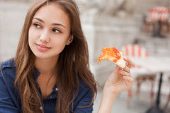 Young tourist woman eating authentic pizza outdoors. Stock Image