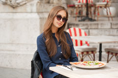 Young tourist woman eating authentic pizza outdoors. Stock Photos