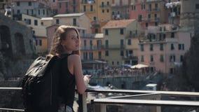 Young Tourist Woman Enjoying View of Manarola City Italy.