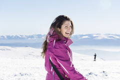 Young tourist woman laughing in a winter  mountain Stock Image