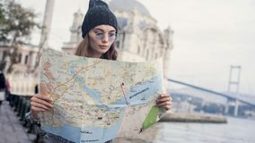 Young tourist woman looking map in outdoors Royalty Free Stock Image