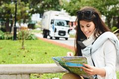 Young tourist woman looking at a map. stock photography