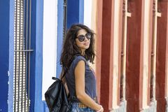 Fashion tourist woman on the street in Italy. Young tourist woman on the main street in Italy Stock Photography