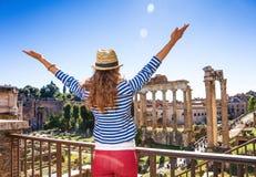 Young tourist woman near Roman Forum in Rome, Italy rejoicing fotos de archivo