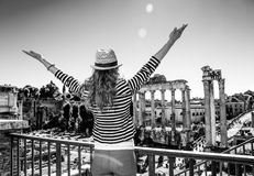 Young tourist woman near Roman Forum in Rome, Italy rejoicing fotografía de archivo