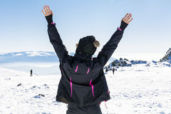 Young tourist woman with open arms  in a winter  mountain Royalty Free Stock Photos