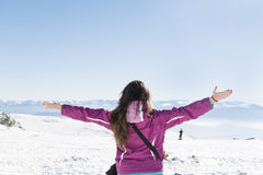 Young tourist woman with open arms  in a winter  mountain Royalty Free Stock Photography