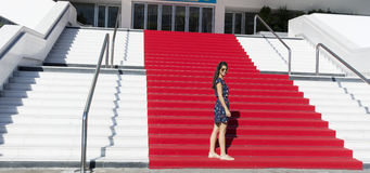 Young tourist woman on the Red carpet in Cannes, France. Stairs of fame Stock Photos