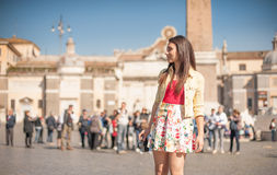 Young tourist woman in Rome smiling looking at the place Stock Photography