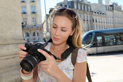 Young tourist woman sightseeing town and taking photos Stock Photos