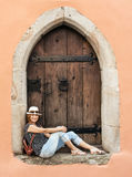 Young tourist woman sits in the old window Royalty Free Stock Photo