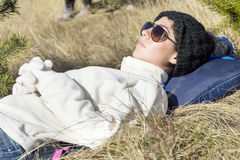 Young tourist woman sleeping on a meadow in the mountain stock image