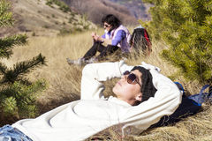 Young tourist woman sleeping on a meadow in the mountain stock photo