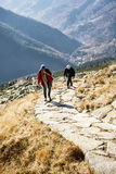 Young tourist woman with son on the mountain footpath leading up Stock Photos