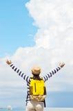 Young tourist woman standing and enjoying a bea. Young tourist woman standing with raised arms and enjoying a beautiful nature Stock Image
