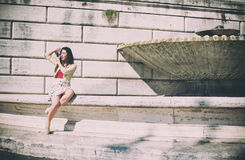 Young tourist woman taking picture with vintage camera outdoor Royalty Free Stock Image