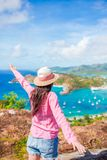Young tourist woman with view of English Harbor from Shirley Heights, Antigua, paradise bay at tropical island in the. View of English Harbor from Shirley Stock Photos