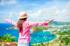 Young tourist woman with view of English Harbor from Shirley Heights, Antigua, paradise bay at tropical island in the. View of English Harbor from Shirley Royalty Free Stock Photo