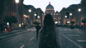 Young tourist woman walking in Piazza di spagna near the Saint Peter Cathedral. Girl looking around, exploring sights. Young tourist woman walking in Piazza di stock video
