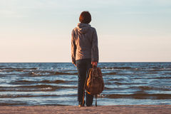 Free Young Tourist Woman With Backpack Looking To Sea Stock Photos - 58769513